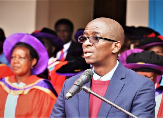 Benard Otieno delivers a speech on behalf of the Association During the 61st Graduation Ceremony